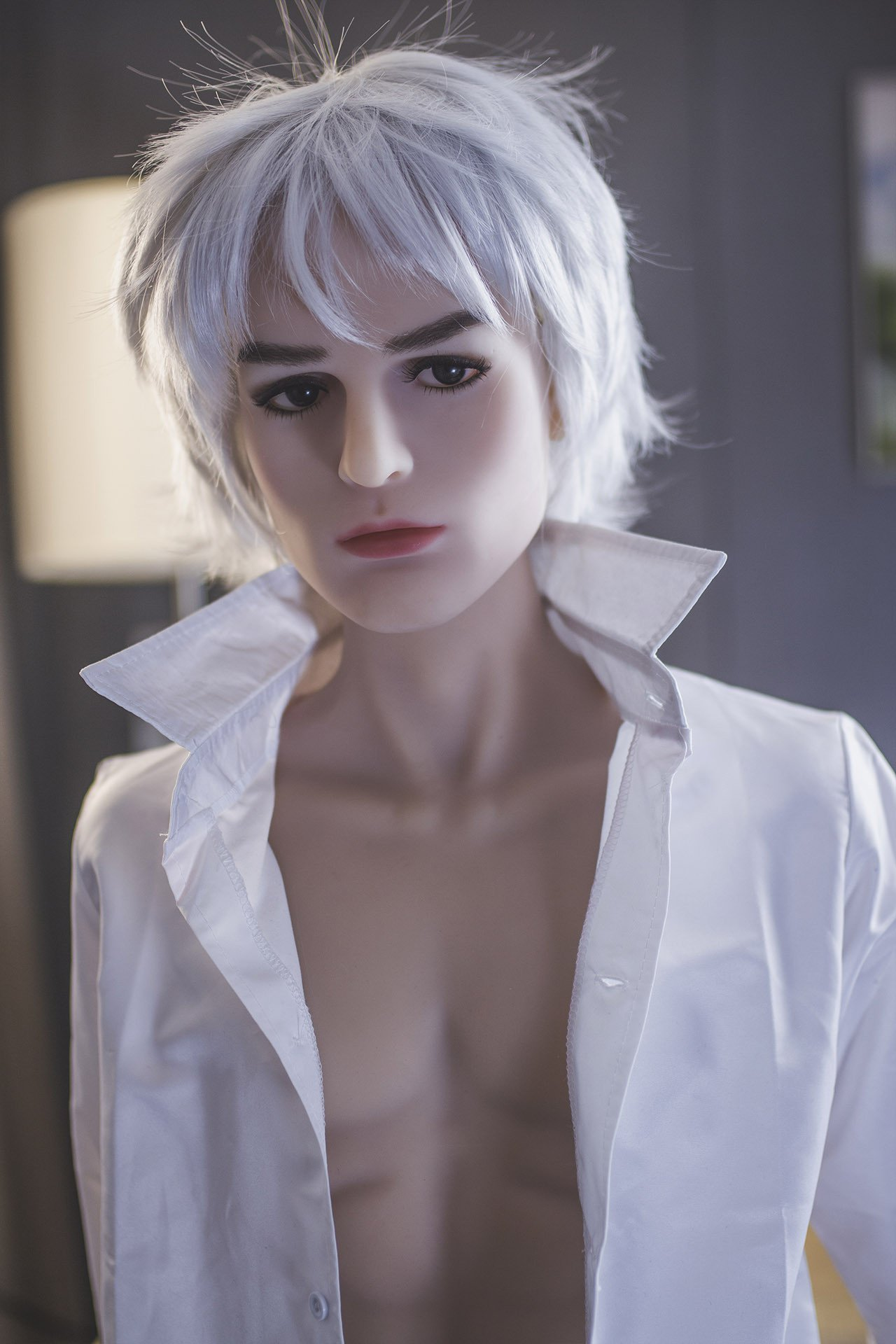Male sex doll with striking features posing