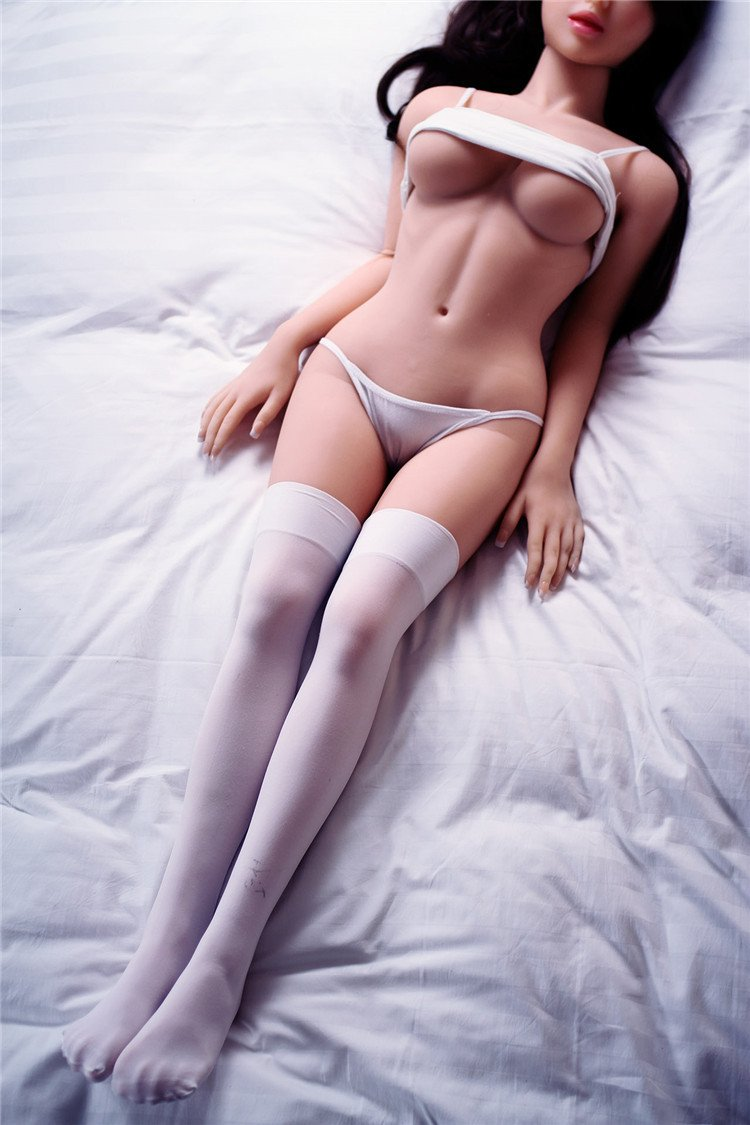sex doll in lingerie laying on bed