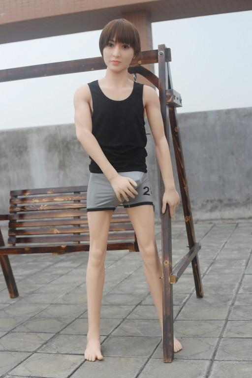Cute male sex doll posing for the camera