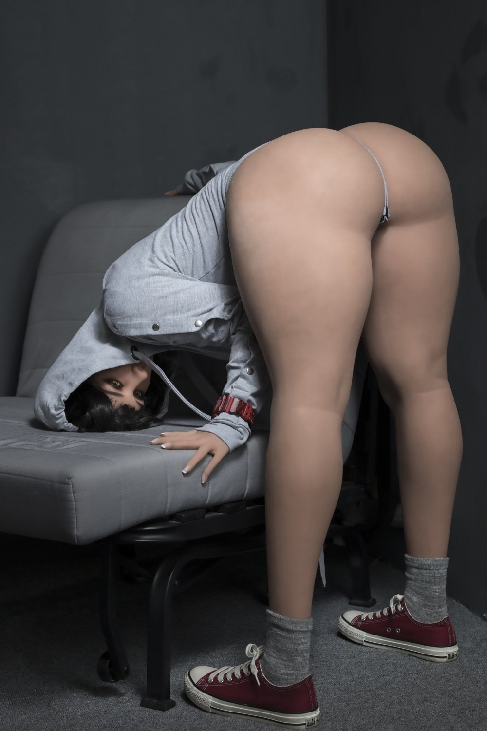 sex doll bent over couch
