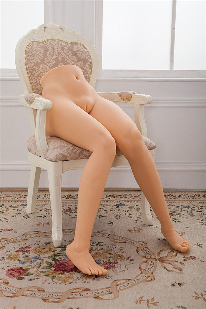 Silicone sex doll posing on chair