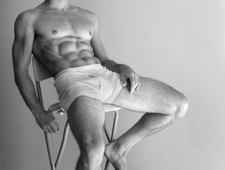 man sitting on chair with amazing body
