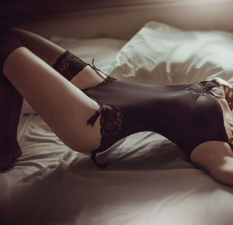 woman on bed in beautiful lingerie and stockings