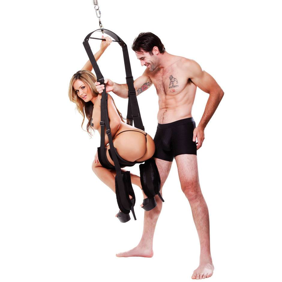 man and women using a sex swing with eachother