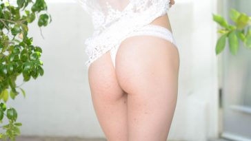 white lingerie on a woman with a bubble butt outside