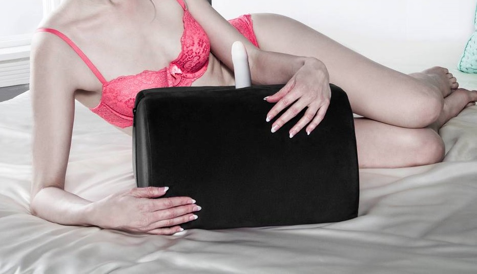 woman holding a sex toy mount