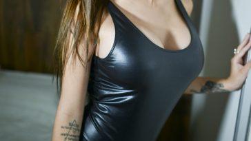 woman in latex bathing suit