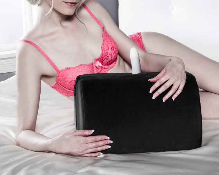 woman holding a sex mount pillow