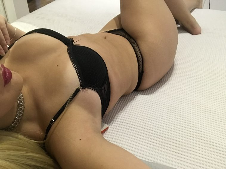 woman laying on bed in sexy black lingerie