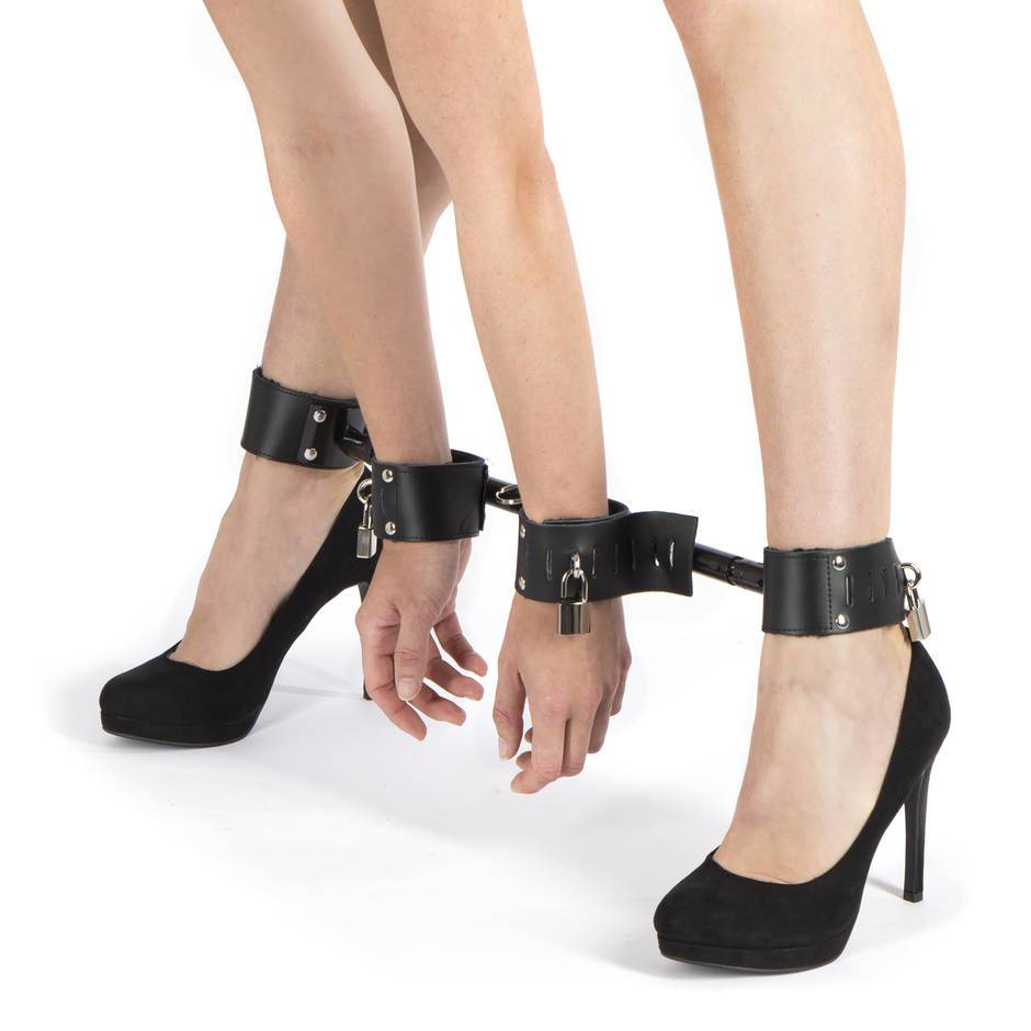 woman in leather spreader bar restraint