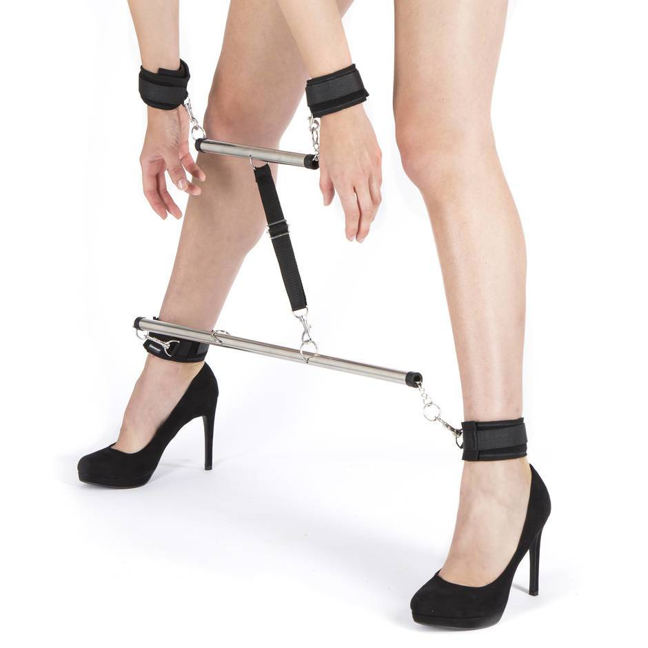 woman with legs and hands in spreader bar