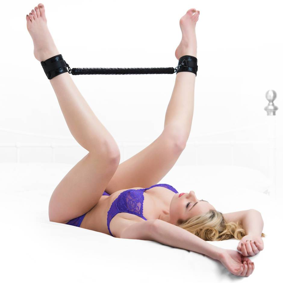 woman laying down using ankle spreader bars