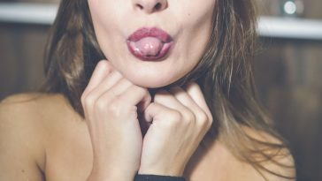 woman poking her tongue out
