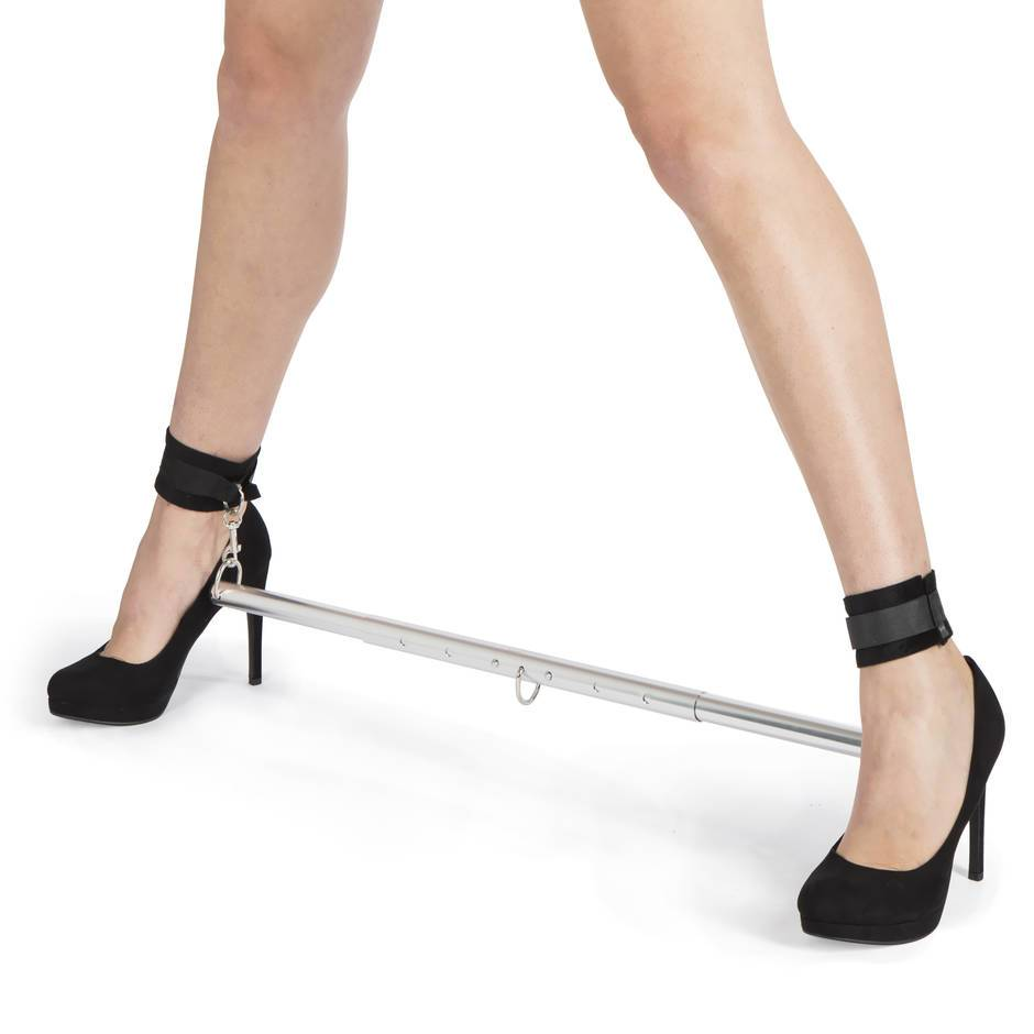 woman wearing a metal spreader bar