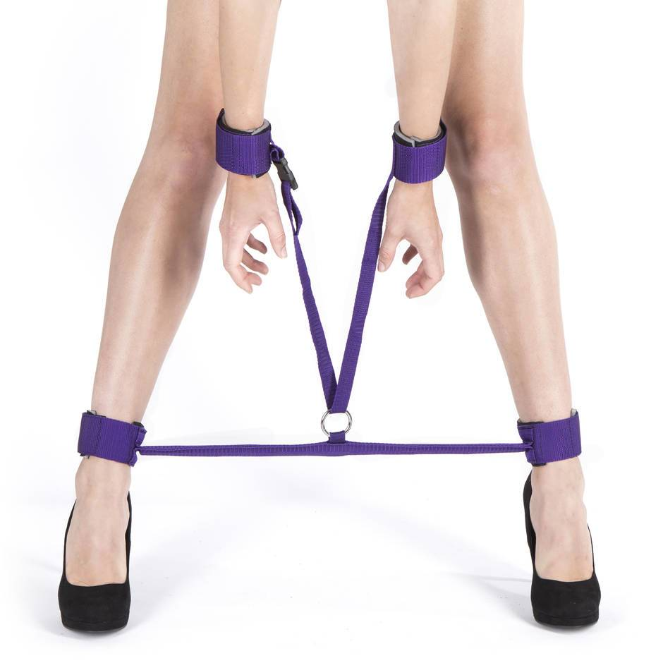 woman being restrained by a spreader bar
