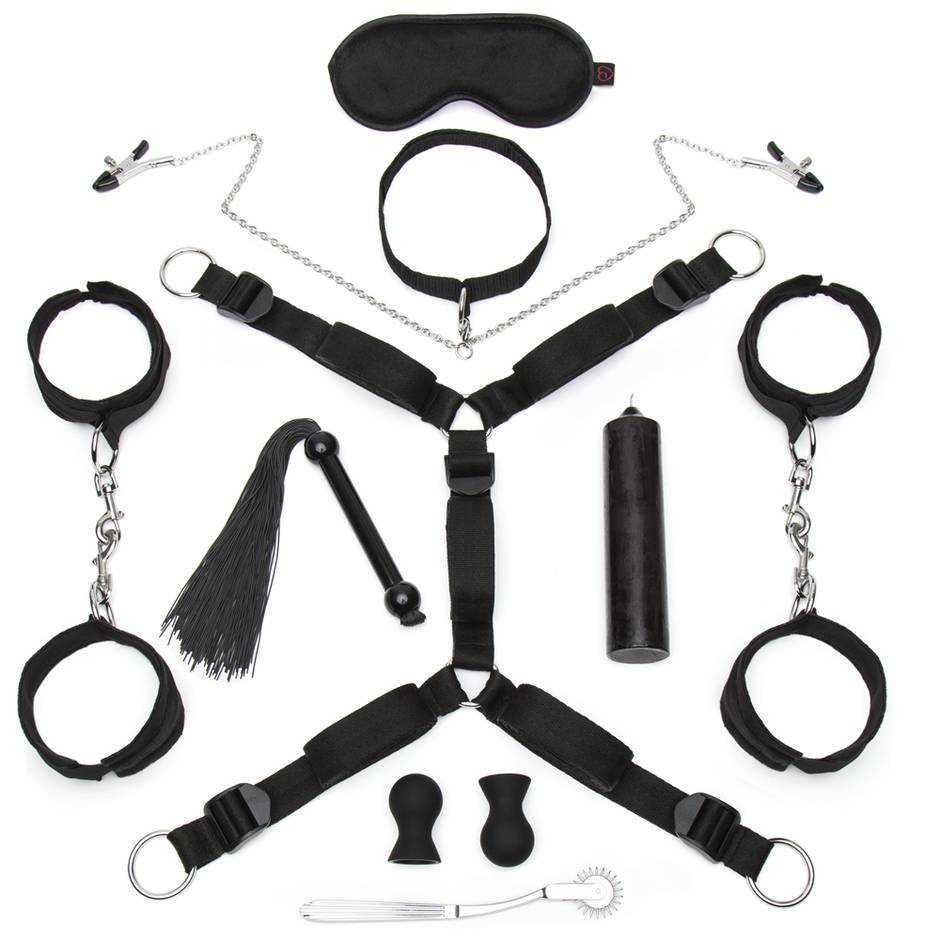 restraint bdsm kit with candles, bed restraints, handcuffs, nipple suckers and pinwheel